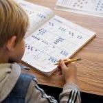 Burbank Montessori Academy Buttercup Student Working on Mathematics