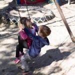 Burbank Montessori Academy Students Help Each Other Swing